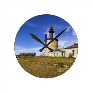 A lighthouse on the islet of Keri, Estonia Round Wall Clocks