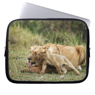 A lioness and her playful cub laptop sleeve
