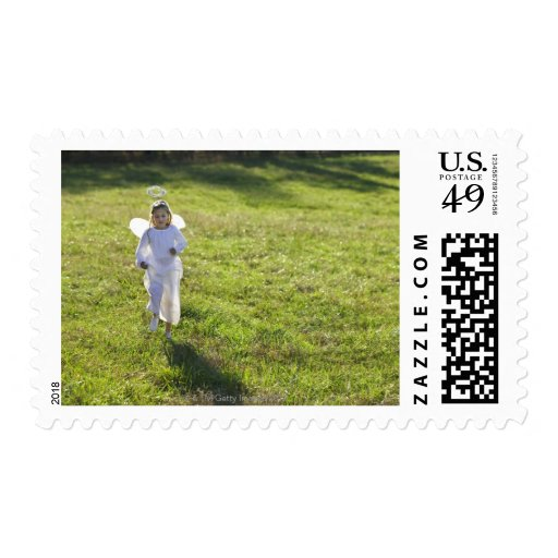 A little angel skips toward the viewer in a stamps