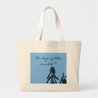 A little bird sitting on top of his world! canvas bags