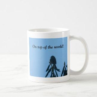 A little bird sitting on top of his world! coffee mug