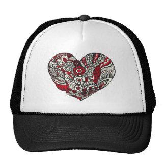 A little bit of red trucker hat
