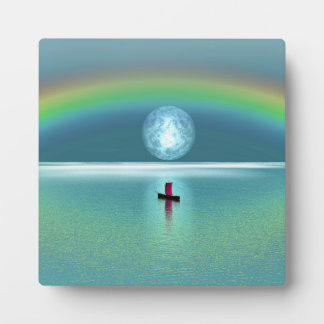 A little boat in the ocean with moon and rainbow plaque
