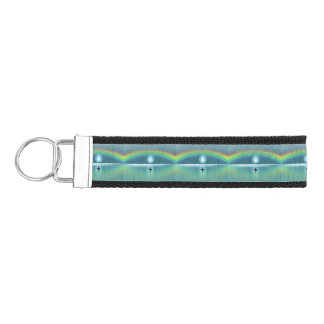 A little boat in the ocean with moon and rainbow wrist keychain