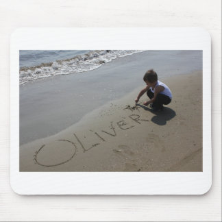 A little boy who writes the name of Oliver Mouse Pad