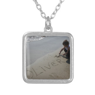 A little boy who writes the name of Oliver Jewelry