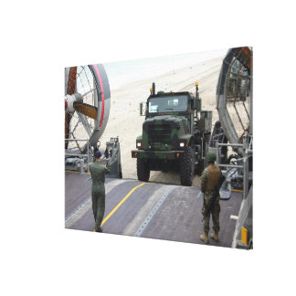 A loadmaster guides a Marine 7-ton truck Gallery Wrap Canvas
