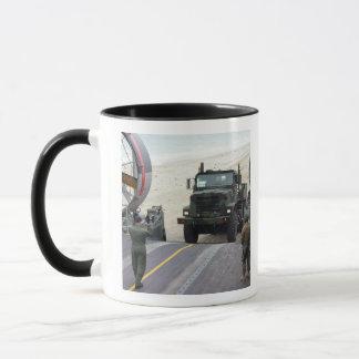 A loadmaster guides a Marine 7-ton truck Mug