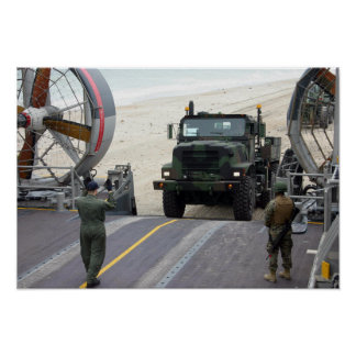 A loadmaster guides a Marine 7-ton truck Poster