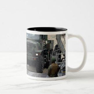 A loadmaster guides a Marine 7-ton truck Two-Tone Coffee Mug