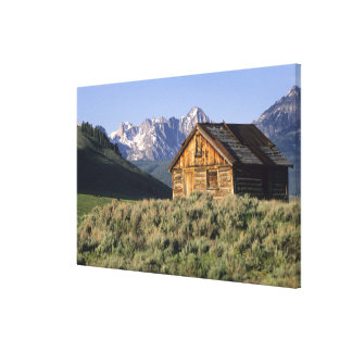 A log cabin and the Sawtooth Mountains in Canvas Print