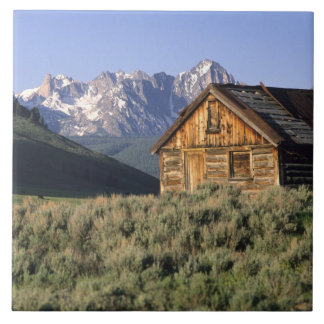 A log cabin and the Sawtooth Mountains in Ceramic Tile