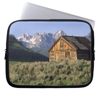 A log cabin and the Sawtooth Mountains in Laptop Computer Sleeve