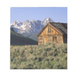 A log cabin and the Sawtooth Mountains in Memo Pad