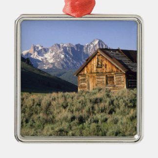 A log cabin and the Sawtooth Mountains in Metal Ornament