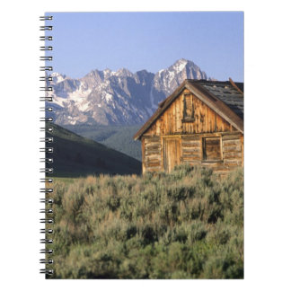 A log cabin and the Sawtooth Mountains in Note Book