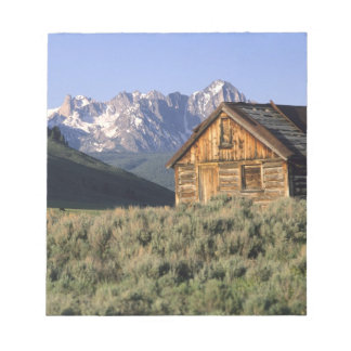 A log cabin and the Sawtooth Mountains in Notepad