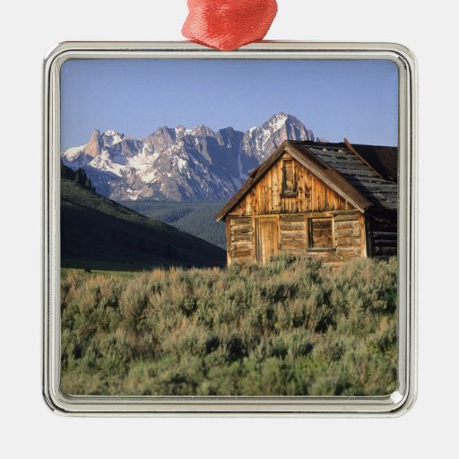 A log cabin and the Sawtooth Mountains in Christmas Tree Ornament