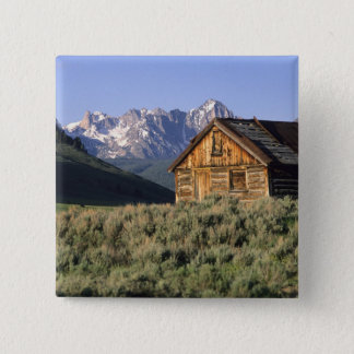 A log cabin and the Sawtooth Mountains in Pinback Button