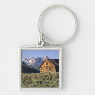 A log cabin and the Sawtooth Mountains in Silver-Colored Square Keychain