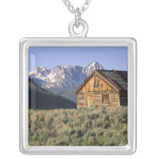 A log cabin and the Sawtooth Mountains in Silver Plated Necklace