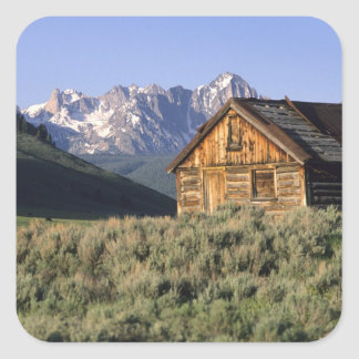 A log cabin and the Sawtooth Mountains in Square Sticker