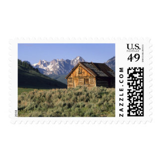 A log cabin and the Sawtooth Mountains in Stamp