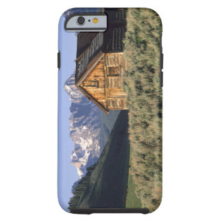 A log cabin and the Sawtooth Mountains in Tough iPhone 6 Case