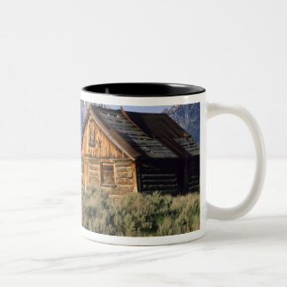 A log cabin and the Sawtooth Mountains in Two-Tone Coffee Mug