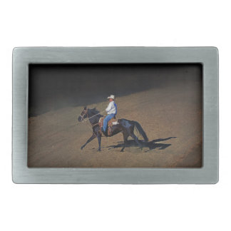 A Lone Cowboy and His Horse Art on a Buckle Rectangular Belt Buckle