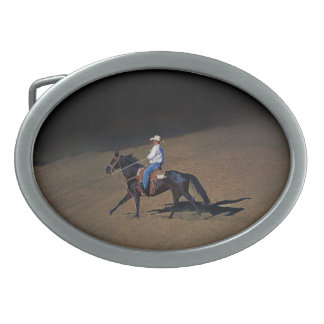 A Lone Cowboy and His Horse Art on a Buckle Oval Belt Buckle