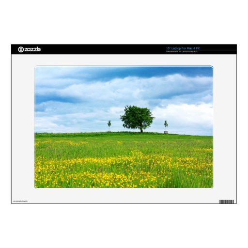 A lonely tree and yellow meadow laptop skins