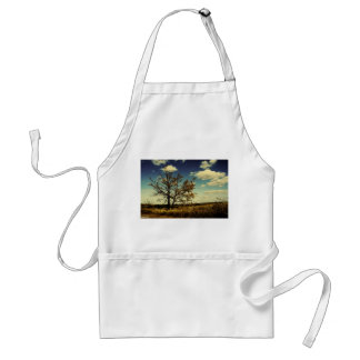 A lonely tree in a yellow dry field adult apron