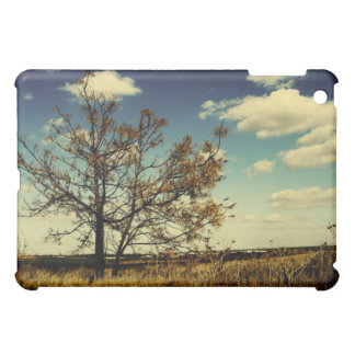 A lonely tree in a yellow dry field iPad mini cases