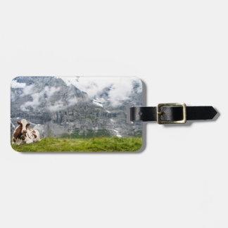 A lonesome cow in the Swiss Alps Bag Tags
