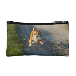 A long haired brown and white Chihuahua Running Cosmetic Bag