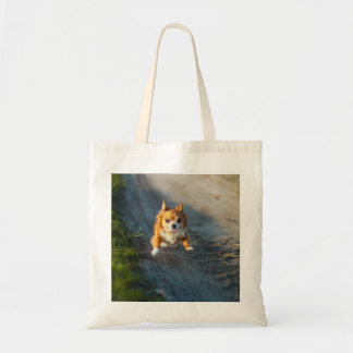 A long haired brown and white Chihuahua Running Tote Bag