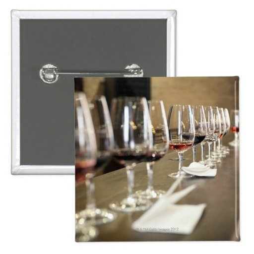 A long row of wine glasses set up so a large button