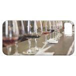 A long row of wine glasses set up so a large iPhone 5 cases