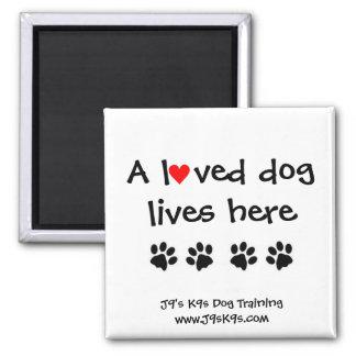 A loved dog lives here Magnet