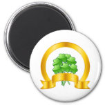 A Lucky Golden Horseshoe with green shamrocks 2 Inch Round Magnet