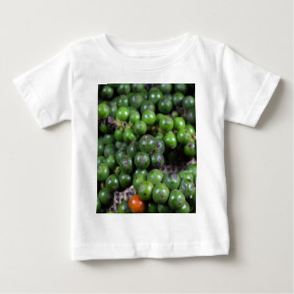 A macro photo of green pepper berries. baby T-Shirt