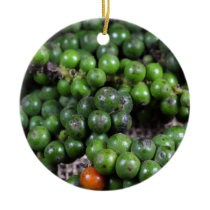 A macro photo of green pepper berries. ceramic ornament