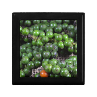 A macro photo of green pepper berries. gift box