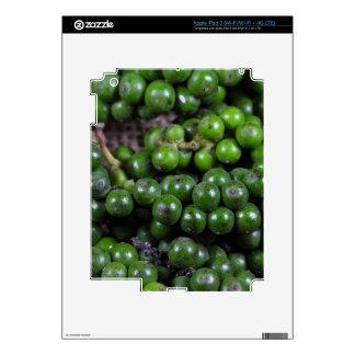 A macro photo of green pepper berries. iPad 3 decals