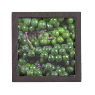 A macro photo of green pepper berries. jewelry box