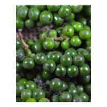 A macro photo of green pepper berries. letterhead