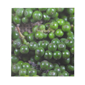 A macro photo of green pepper berries. notepad