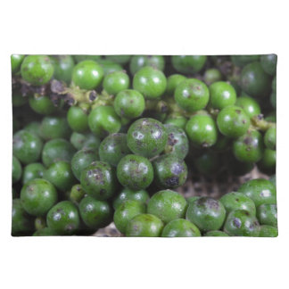 A macro photo of green pepper berries. placemat
