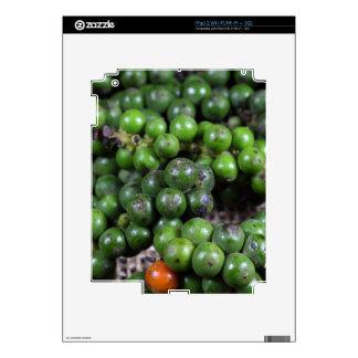 A macro photo of green pepper berries. skin for iPad 2
